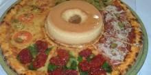 مطعم برازيلي يلفت الأنظار بطريقته الغريبة في تقديم البيتزا