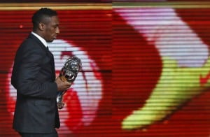 UAE's Ahmed Khalil walks after receiving the Asian Football Confederation (AFC) Player of the Year trophy during the AFC Annual Awards 2015 in Gurgaon on the outskirts of New Delhi, India, November 29, 2015. REUTERS/Anindito Mukherjee