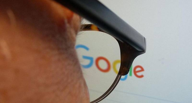 "A journalist looks at the new Google logo at his work station in Washington, DC on September 1, 2015. Google on Tuesday refreshed its logo to better suit mobile devices that are supplanting desktop computers when it comes to modern Internet lifestyles. Google's logo keeps its four-color scheme but shifts to a soft sans-serif font. The company is also replacing the well-known blue lower case ""g"" icone with an upper-case ""G"" combining blue, green, red and yellow colors. The 17-year-old Internet company is keen to follow users of its online products onto new generations of Internet-linked devices such as smartphones, tablets, and watches.AFP PHOTO / EVA HAMBACH        (Photo credit should read EVA HAMBACH/AFP/Getty Images)"