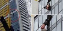 بالفيديو: عامل تنظيف كاد يسقط من الطابق 15