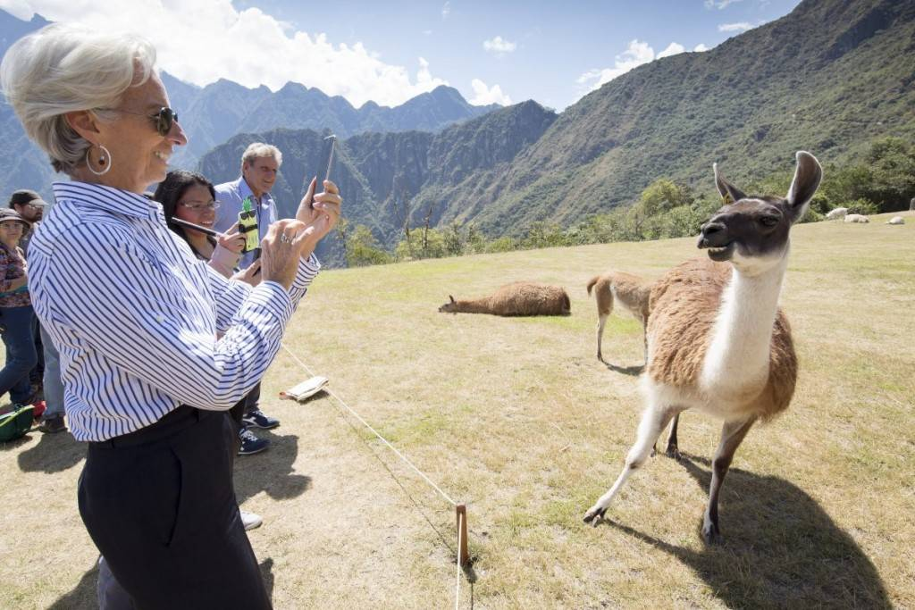 international-monetary-fund-imf-managing-director-christine-lagarde-takes-a-photo-of-a-llama-during-her-tour-of-machu-picchu-peru-1024x683