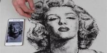 حلاق صيني يستعمل شعر زبائنه لرسم لوحات فريدة ومبهرة