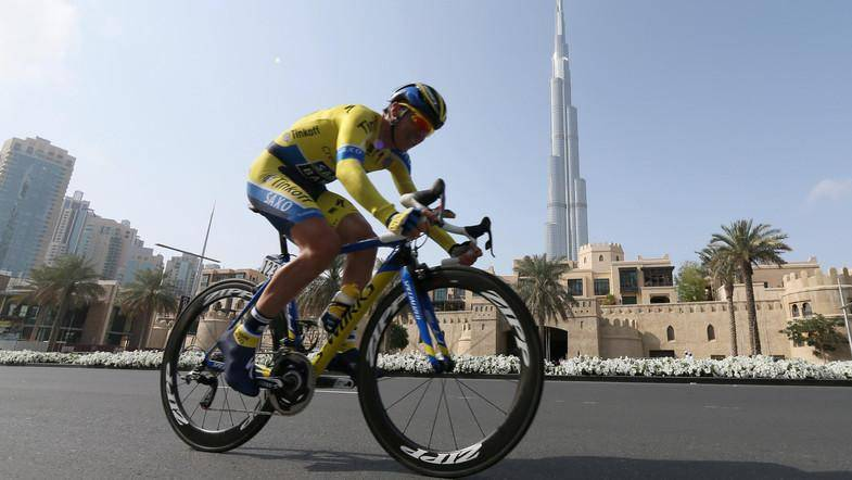 Italian cyclist Eugenio Alafaci, of Trek Factory Racing Team, rides past the Khalifa Tower during the four-stage event's 9.9 kilometre time trial as part of the Tour of Dubai on February 5, 2014 in the United Arab Emirate of Dubai. Taylor Phinney rode into cycling's history books, the American claiming the first stage on the inaugural Tour of Dubai. AFP PHOTO/KARIM SAHIB