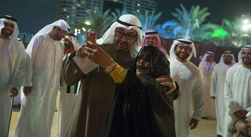 ABU DHABI, UNITED ARAB EMIRATES - February 03, 2016: HH Sheikh Mohamed bin Zayed Al Nahyan Crown Prince of Abu Dhabi Deputy Supreme Commander of the UAE Armed Forces (L) stands for a photo with a guest during the opening day of the Qasr Al Hosn Festival.  ( Mohamed Al Hammadi / Crown Prince Court - Abu Dhabi ) ---