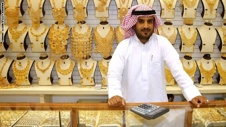 DUBAI, UNITED ARAB EMIRATES - SEPTEMBER 25:  A gold merchant poses with his jewellery at the Dubai Gold Souk on September 25, 2014 in Dubai, United Arab Emirates.  (Photo by Warren Little/Getty Images)