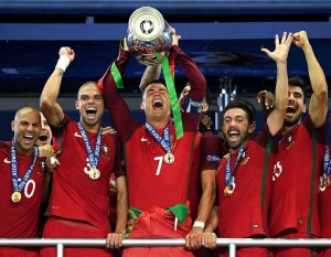 PARIS, FRANCE - JULY 10:  Cristiano Ronaldo of Portugal (c) lifts the Henri Delaunay trophy after his side win 1-0 against France during the UEFA EURO 2016 Final match between Portugal and France at Stade de France on July 10, 2016 in Paris, France.  (Photo by Matthias Hangst/Getty Images)