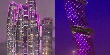 بالصور | اللون البنفسجي يتنشر على بنايات أبوظبي دعما لنادي العين