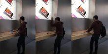 """شاهد بالفيديو رجل يقتحم متجر """"آبل"""" ويحطم أجهزة الآي فون"""