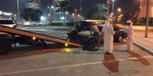بالصور | سحب 14 مركبة وتنبيه 21 في أبوظبي