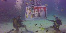 بالصور | فريق غوص سعودي يحتفل باليوم الوطني الإماراتي في أعماق البحار