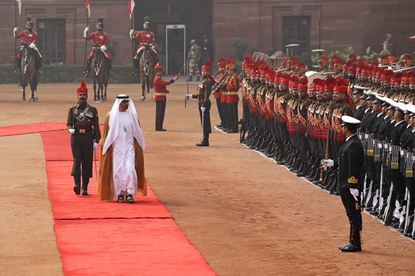 Abu Dhabi's Crown Prince Sheikh Mohammed bin Zayed Al Nahyan inspects a Guard of Honor durng a ceremonial reception at the Presidential Palace in New Delhi, India, Wednesday, Jan. 25, 2017. The crown prince will be India's chief guest at Thursday's Republic Day celebrations. (AP Photo/Manish Swarup)