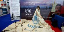 عرض ثوب عالمي  في دبي مصنوع من قماش خيمة عائلة سورية لاجئة
