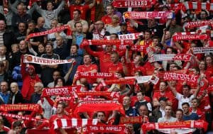 LIVERPOOL, ENGLAND - AUGUST 17: Fans sing on the kop during the Barclays Premier League match between Liverpool and Stoke City at Anfield on August 17, 2013 in Liverpool, England. (Photo by Clive Brunskill/Getty Images)